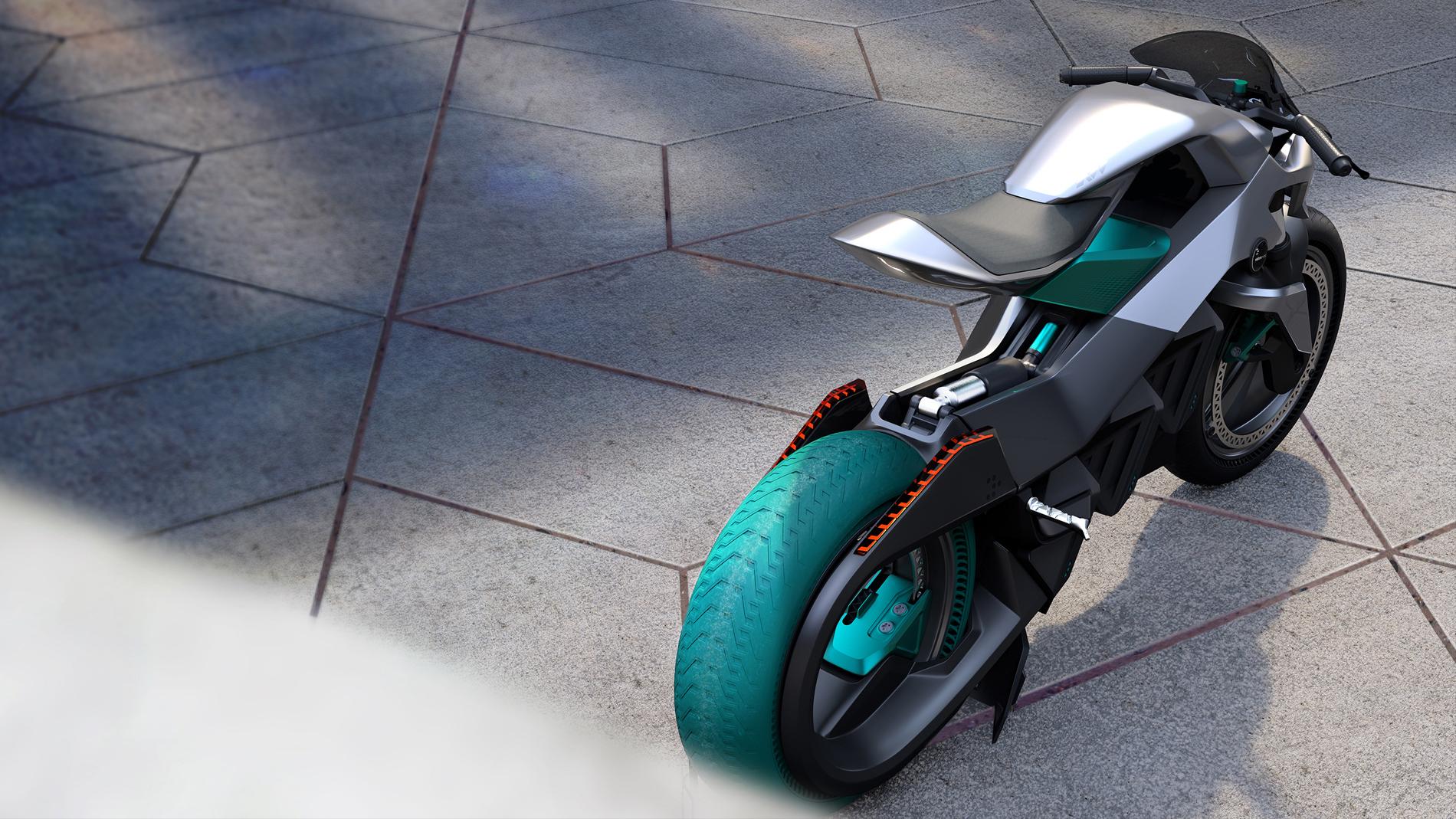grey black green motorbike on asphalt back top view