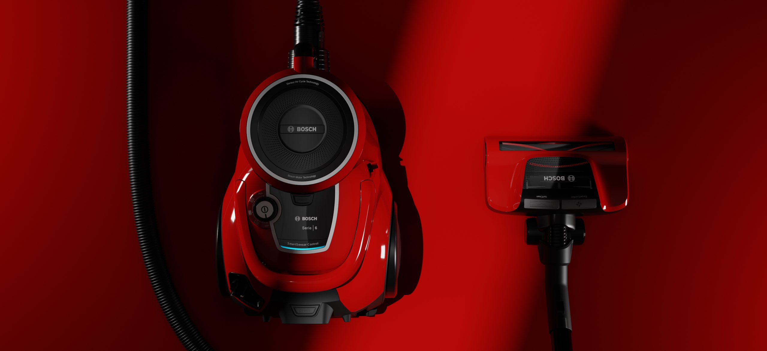 red bosch vacuum cleaner on red ground in dramatic light scene