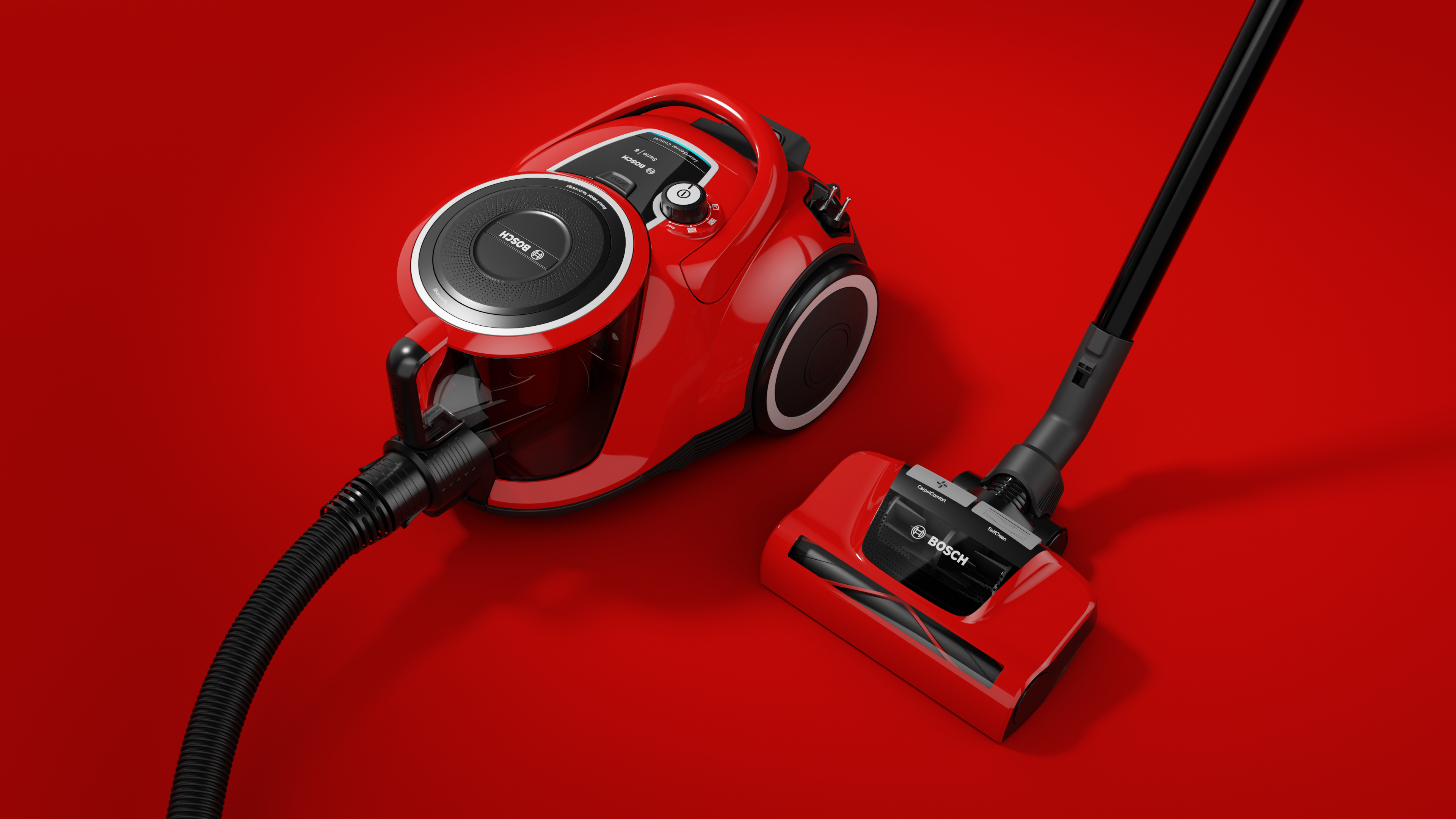 red bosch vacuum cleaner on red ground perspective view
