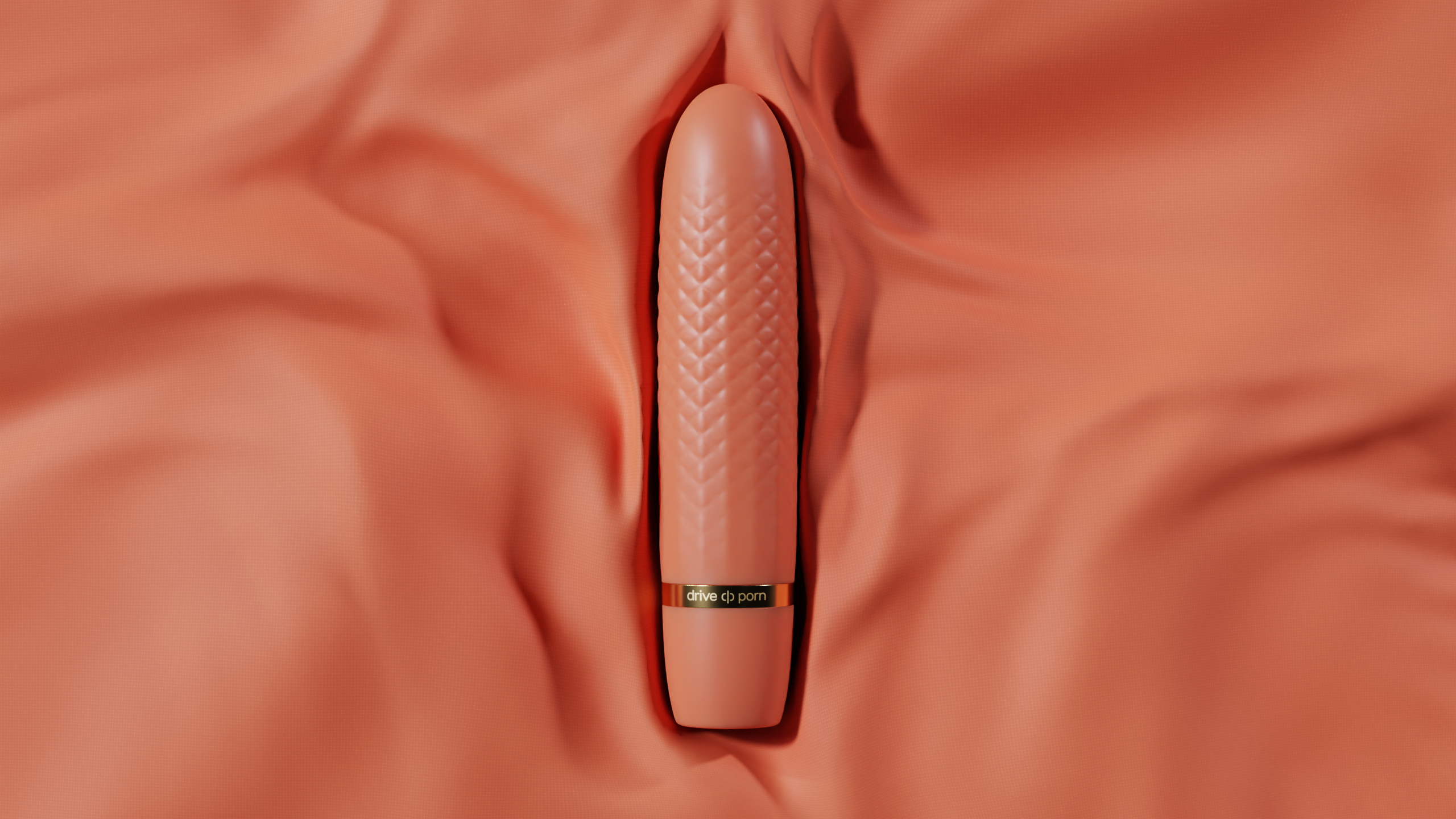 orange structured adult toy with golden text lying on orange fabric