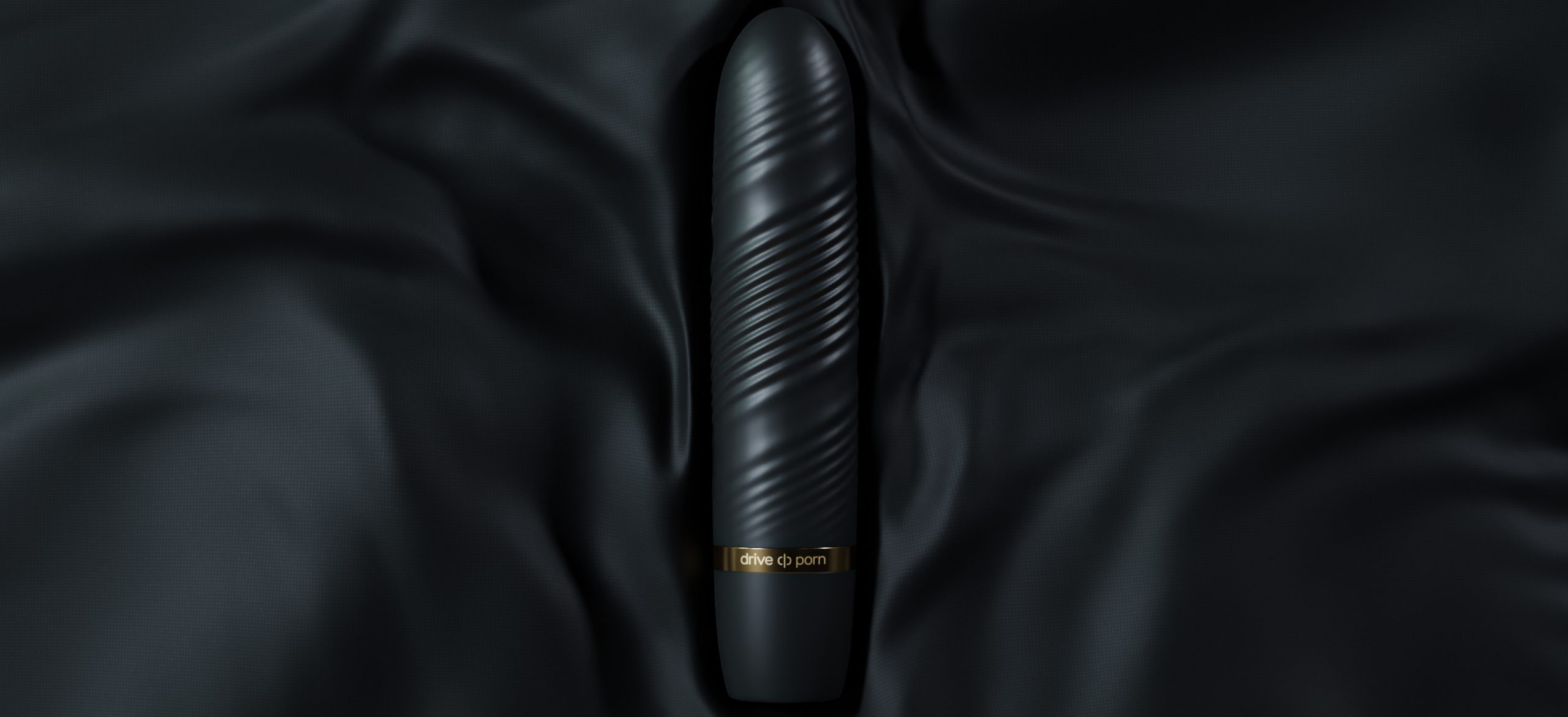 black adult toy with golden text lying on balck fabric