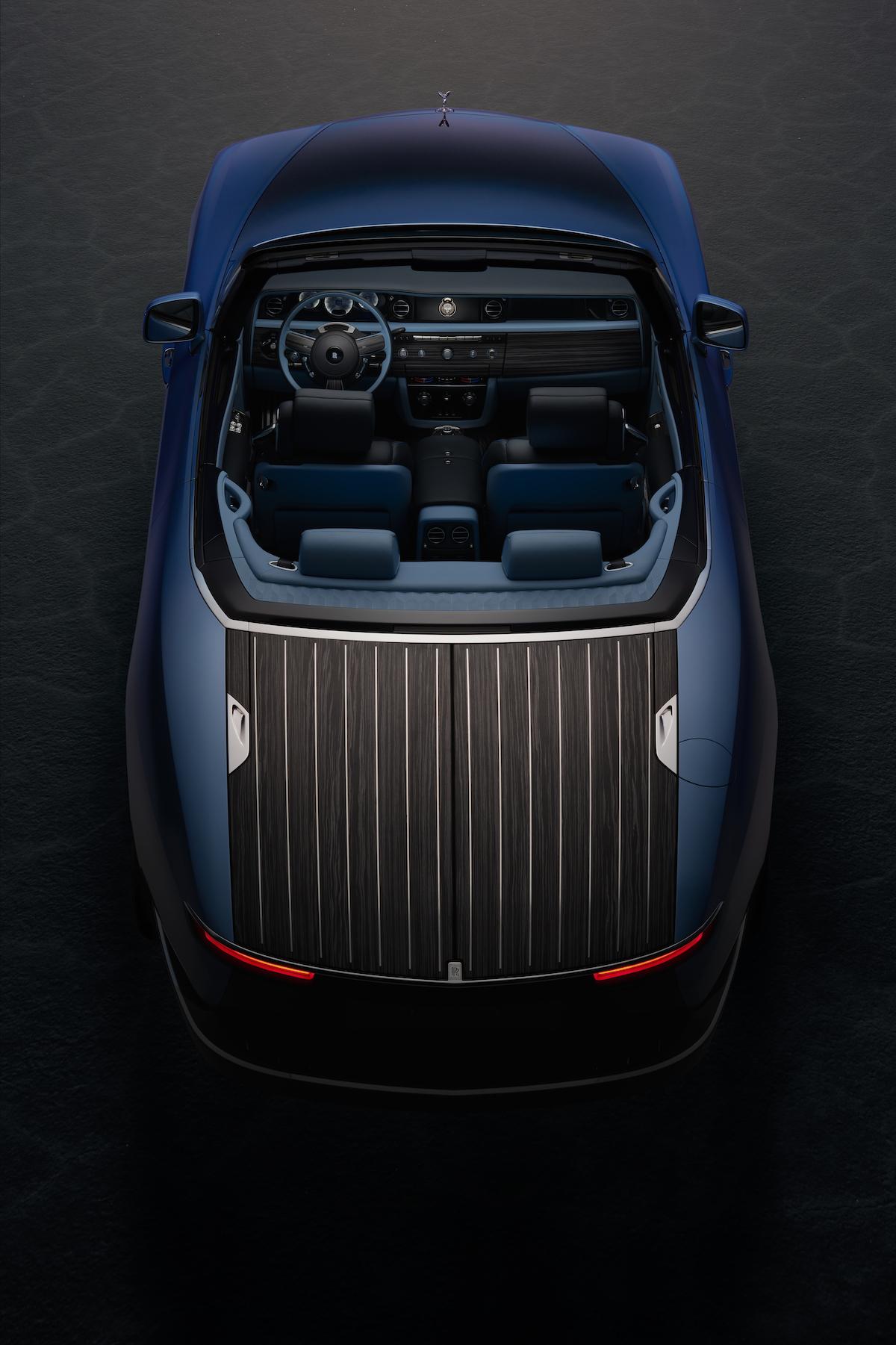marine blue luxury car Rolls Royce Boat Tail rear view on black ground