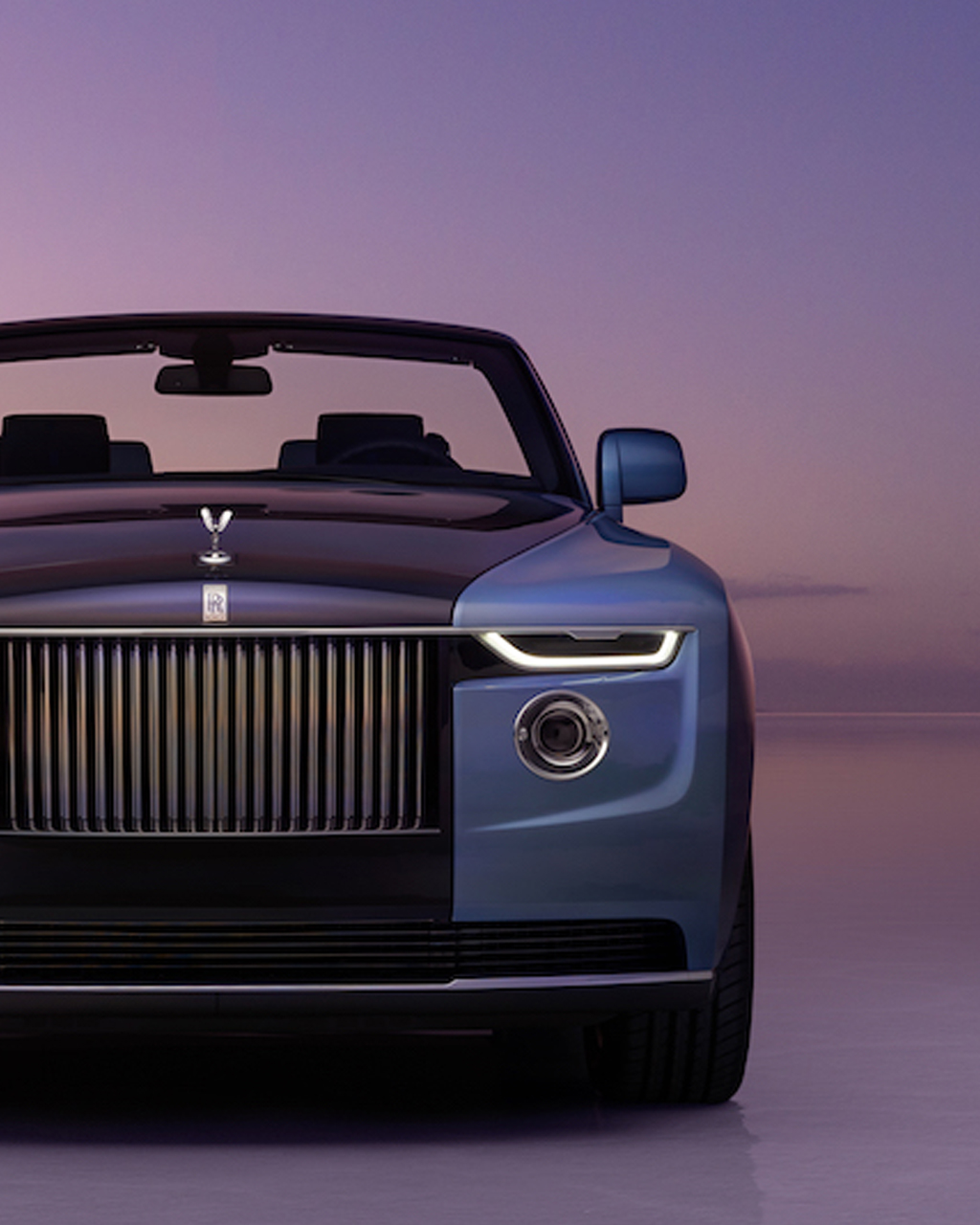 marine blue luxury car Rolls Royce Boat Tail front view on water sky background sunset
