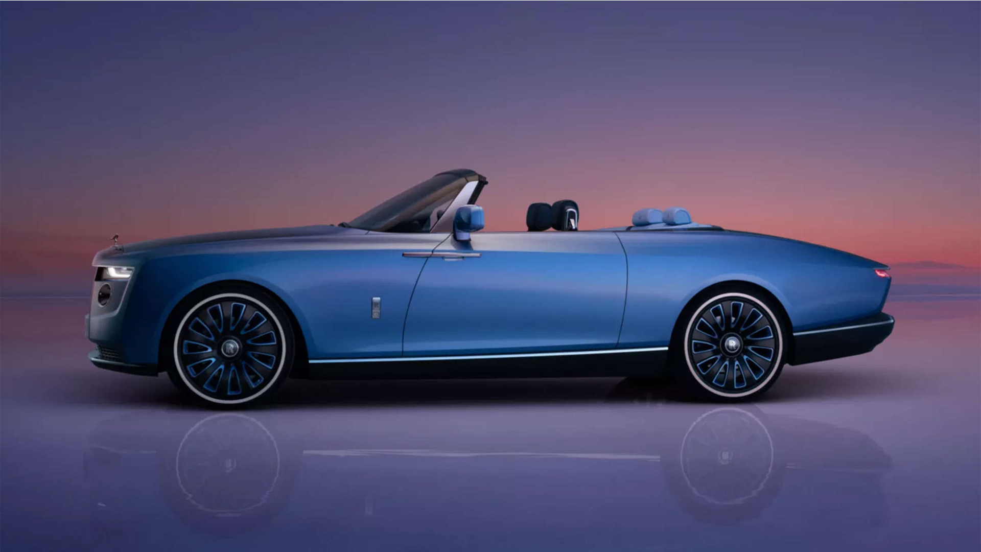marine blue luxury car Rolls Royce Boat Tail side view on background sunset