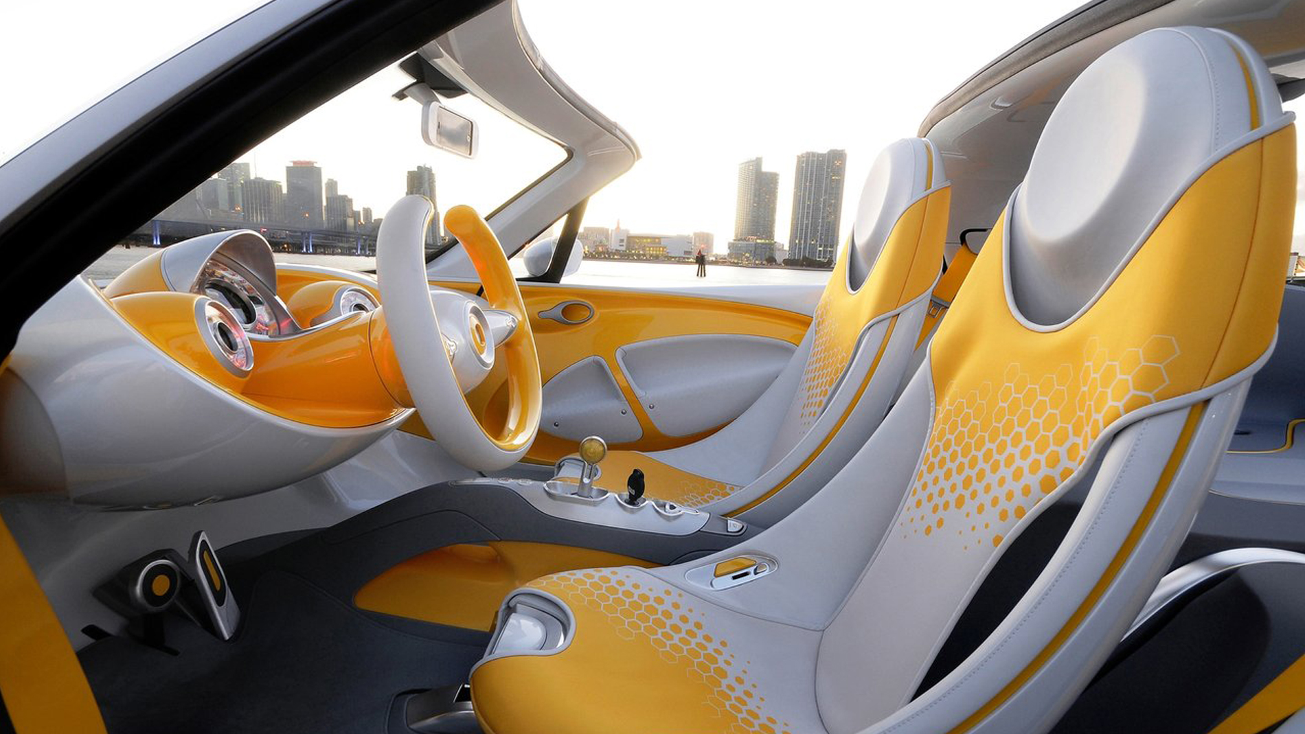 yellow white interieur car entrance perspective on city with river in background