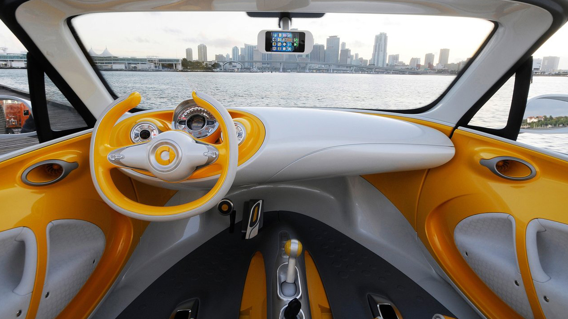 yellow white interieur drivers perspective on city with river
