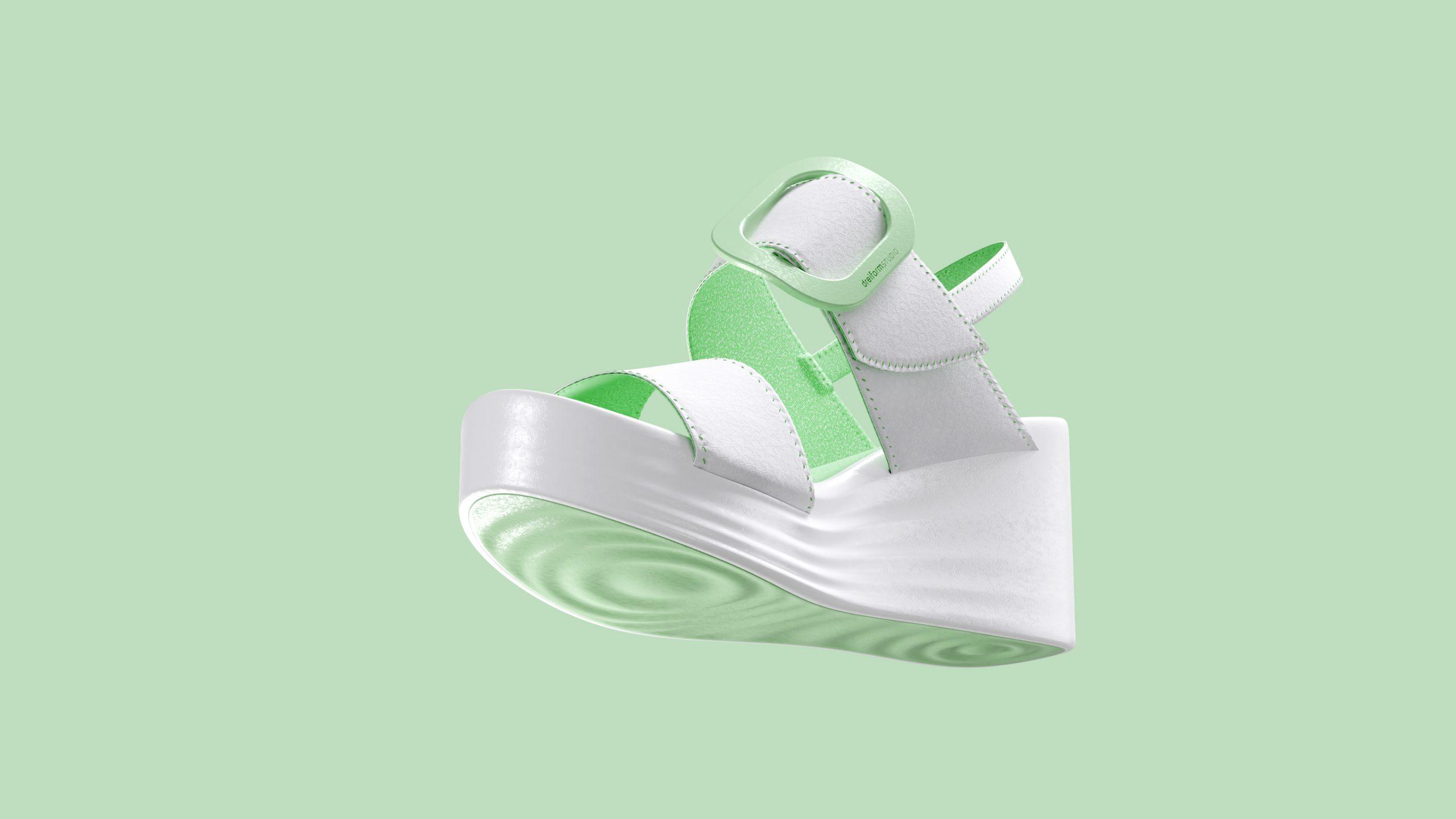 dreiformstudio white concept wedge sandals on green background, view below